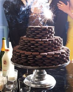 """Milk, cookies and champagne for New Year's.  Yes, that's a """"cake"""" constructed out of Oreos!"""