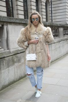 Pin for Later: Distressed Denim Is the Easiest Spring Trend You Haven't Tried Yet  Err on the right side of boho with a luxurious fur coat.