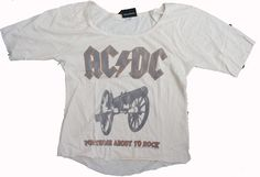 """This is a very cool AC/DC Womens Tri Blend Slouch Raglan Shirt by Junk Food Clothing. On the front it says """"For Those About To Rock"""" with the AC/DC font and canon, and also says About to Rock with concert dates from the We Salute You Tour in 1981 on the back."""