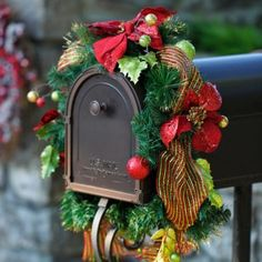 Spread the holiday cheer to every corner of your home with our Holly Jolly Poinsettia & Ribbon Mailbox Swag! #Kirklands #HollyJolly #holidaydecor