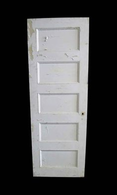 Wooden white right swing passage door with five horizontal panels. The door has distressed and peeling paint on the opposite side, revealing tan […]