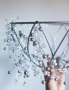 DIY Chandelier Made From a Hanging Plant Basket | http://www.hammerandheelsblog.com/diy-chandelier/