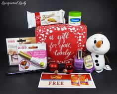 Contents of the #JingleVoxBox from @influenster, received free for testing purposes #KISSLashes #PureIce #OreIdaTotchos #IttyBittys #Cheerphil #MyBiscoffBreak #CityProofNYC