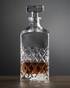 Our handsome Hatch decanter looks like an heirloom classic, adding a touch of tradition to the bar or bar cart. Each glass decanter resembles cut crystal, with a diamond crosshatch pattern made from carved wooden molds. Designed to coordinate with our Hatch barware, the decanter adds a time-honored look to stored whisky, bourbon or scotch.