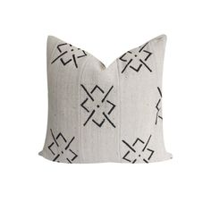 The pillow front is made from authentic African Mud Cloth, and the back is a natural, flax colored cotton.This is a Bogolan African Mud Cloth, which is created by the Bamana tribe in Mali. The tribe uses a unique procedure that makes dyes from mud and leaves. Then the men weave the cotton cloth in narrow strips and sew them together.Please note that because the Mud Cloth is made by hand, there may be some imperfections, and patterns may vary slightly.Care instructions: D...