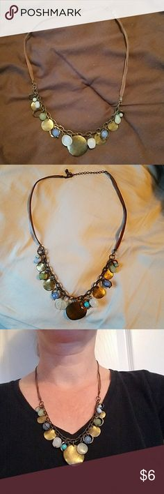 Awesome bead and medallion necklace This necklace is awesome!  Looks great with browns, blues, greens, golds,  and yellows.  Necklace length is adjustable as well. Jewelry Necklaces