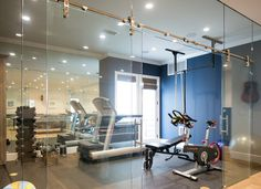 The basement also features an amazing gym with full wall of glass.