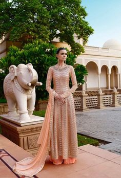 Magnify the wedding pageant by adorning this dress in beige color. This dress is designed with all over sequin work, heavy floral embroidery and lace border. The dress comes with net top and premium net skirt with net dupatta.