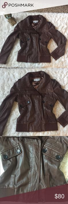Pelle Studio Leather Bomber by Wilson Leather 100% leather outer shell with polyester lining. Excellent condition with soft leather in a rich chocolate brown. Stylish bomber cut with neckline that can be worn open or closed (see pics) and stretch details at sleeve cuffs and bottom. I tried to model the flattering cut, but it is one size too small for me. There are loops where a belt could be added but no belt included. This will be your new go-to jacket! Wilsons Leather Jackets & Coats