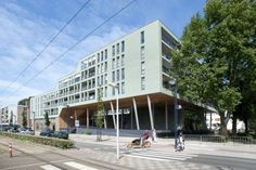 De Opgang Church, apartments and children's daycare, Amsterdam, Netherlands - The outside elevations are clad in green brick and timber. These materials were chosen to merge with the park atmosphere and give the building an autonomous  character.