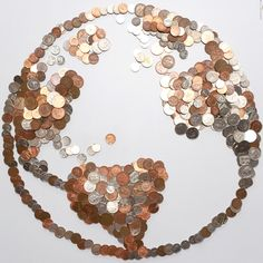 Coins in a globe.  Money Makes the world go round From the PaintSewGlueChew instagram feed.