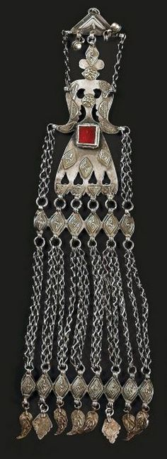 Turkestan | Temporal pendant ~ engse lik ~ from the Yomud people | Silver, silver gilt and carnelian | 20th century