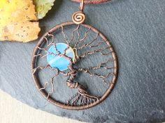 Copper Tree of Life pendant with opalite full moon. This is a one of a kind wire wrapped pendant crafted from antiqued copper wire. But now or pin to save