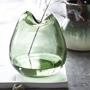 Palm Vase - This little mouthblown glass vase has a beautiful organic shape with a curled edge resembling an unfolding leaf. https://www.curiousegg.com/product/palm-vase/