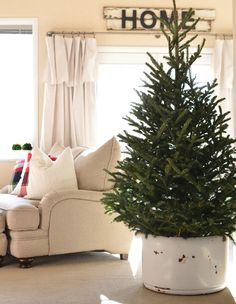 A holiday tour of a cozy farmhouse basement decorated for the Christmas season.