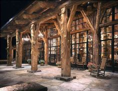 Solid glass and log home.  Amazing porch with the huge tree trunks serving as structural support.  Montana/Idaho Log Home Company, Victor, Montana..... I could live in this house....can you imagine the views out of these windows?