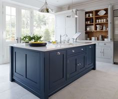 "Color of island with lighter blue on back cabinets. Butcher block on island and quartz ""marble"" on back countertops. Kitchen Tiles, Kitchen With Blue Cabinets, Kitchen Island Butcher Block, Hague Blue Kitchen, Blue Kitchen Ideas, White Kitchen Worktop, Grey Kitchen Floor, Large Kitchen Island, Gray Cabinets"