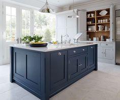 dark blue kitchen with cream tiles