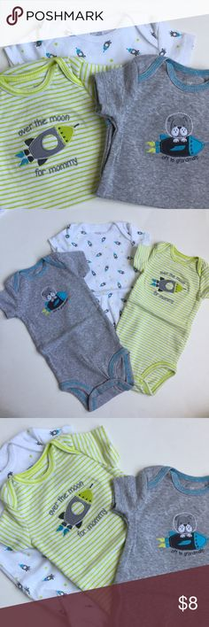 """Carter's rocket onesie set as 3 months Carter's rocket onesie set. Size: 3 months. One white onesie with rocket ship print, one gray onesie with """"Off to Grandma's"""" embroidered decal and one green striped onesie with """"Over the moon for mommy"""" embroidered decal. Cotton. Cute. Washed but never worn. Great preowned condition. Carter's One Pieces Bodysuits"""