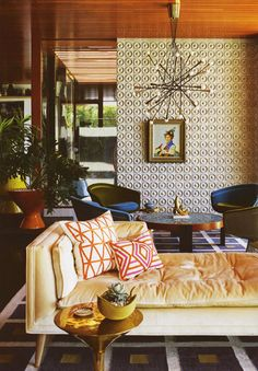 Textured wall / Mod chandelier / retro colours / Jonathan Adler interior