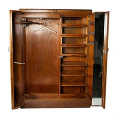 For Sale on 1stdibs - A late 1920s oak ladies 'Compactom' wardrobe. The fitted interior is labeled for a different type of women's attire of the period, the shelves and hanging