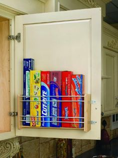 """Rev-A-Shelf Foil Rack Door Mount 13-1/8in Wide by Rev-A-Shelf. $41.06. 13-1?8"""" W x 4"""" D x 8"""" H. Screws included. This beautiful wood organizer brings your foil and storage bags within easy reach. Minimum Opening 13-3/4"""". Mounting brackets have up to 5"""" of adjustability, just loosen screws, adjust, then retighten.. Made from maple with chrome rails it is ideal for any decor and the patented adjustable mounting brackets ensure easy installation on various door styles"""