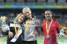 (L to R) Silver medalist Martina Caironi of Italy , Gold medalist Vanessa Low of Germany and Bronze medalist Malu Perez Iser of Cuba celebrate on the podium at the medal ceremony for the Womenâs Long Jump â T42 Final during day 3 of the Rio 2016 Paralympic Games at the Olympic Stadium on September 9, 2016 in Rio de Janeiro, Brazil.