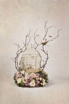 "What a pretty arrangement with the bird cage. I wonder if I could do something on a larger scale like this with my big cage? ""Made by Heather Page"""