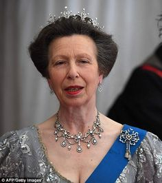 Princess Anne added a slick of red lipstick to her look