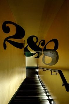 The 2&8 branding shown as a trompe l'oeil descending the stairs    The club is housed in the basement of private members club Morton's on Berkeley Square, and uses a design that celebrates 'mid-century glamour', according to Mystery.