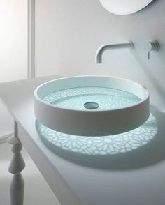 a beautiful glass sink with a pattern is a chic idea for a modern bathroom