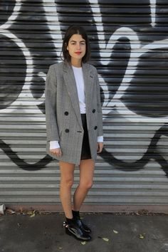 Pair a boxy blazer and mini skirt for this look.