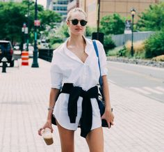 Only Candice Swanepoel can make the menswear classic feel THIS cool. Bonus: that blue bag is amazing on bright white.