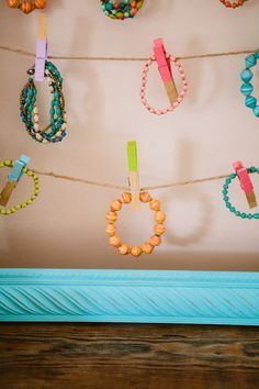 "Cute way to see all the beaded bracelets in a consignment or resale shop! TGtbT.com says ""Note that the clothes pins are dipped in season-appropriate colors"" Click for lots of jewelry display ideas on our resale shopkeeper blog"