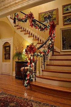 Christmas staircase. My parents always decorated the staircase like this, I cannot wait until we move into a home with stairs so I can do the same!