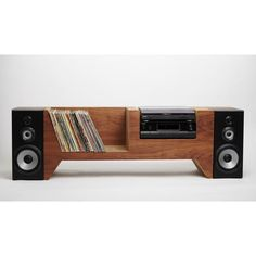 A custom record player console made to hold your record player, audio equipment, speakers, and a collection of records, with a secret