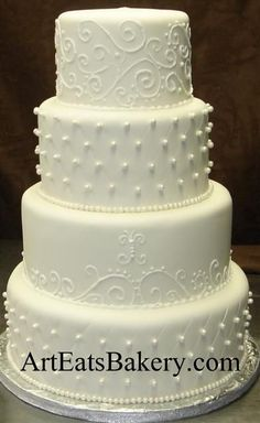 elegant wedding cakes | Four tier round elegant traditional white fondant wedding cake with ...