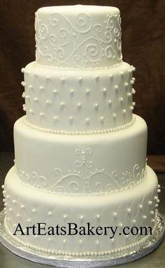 elegant wedding cakes   Four tier round elegant traditional white fondant wedding cake with ...