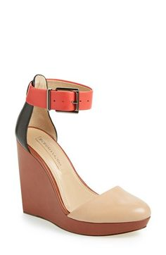 Soft color-blocked leather adds a playful vibe to an ankle-strap sandal set on a sky-high wedge heel.