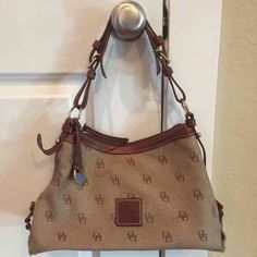 "Dooney & Bourke Tan Signature Handbag Super cute and like new Dooney & Bourke handbag! Measures 13"" wide and 8.5"" tall! Strap drop is 8"" and adjustable!! Checkout my closet too!! Dooney & Bourke Bags Shoulder Bags"