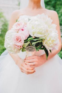 Bouquet with antique brooch | Photography: I Love You Too Weddings - www.iloveyoutooweddings.com  Read More: http://www.stylemepretty.com/2014/06/02/modern-art-museum-wedding/
