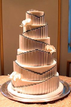 Art Deco-style cake uses sugar orchids to break up its elegantly linear pattern. Mark Joseph Cakes New York City.