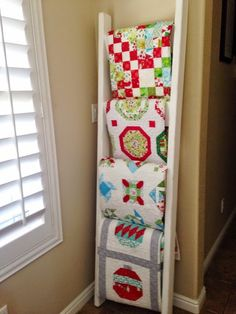 Quilt ladder, love this idea to display Xmas quilts. A Quilting Life -