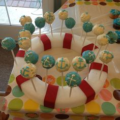 Nautical cake pops - LOVE the display! It's a foam wreath from the dollar store