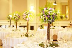 Rustic tree centrepiece with log stand - Real Wedding Four Seasons Hampshire