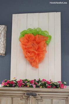 Happy Monday everyone! Continuing on with my Easter theme and sharing my new door/wall bling today… an Easter Mesh Carrot Wreath. Materials needed: • Straw wreath • Orange mesh & green mesh (got them 50% off at Michael's) • Greenery pins • Knife • Plastic cling wrap This is a pretty easy project, but I …