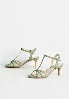 Splendid Heel in Thyme. Descending the grand staircase, these T-strap heels by Seychelles cast a quiet echo through the gallery. #green #wedding #bride #bridesmaid #modcloth