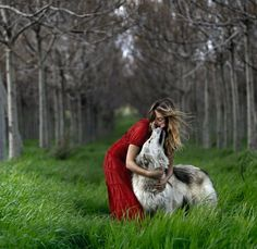I love everything about this picture. Gorgeous red dress. Beautiful dog/wolf. Incredible scenery. Diana H.