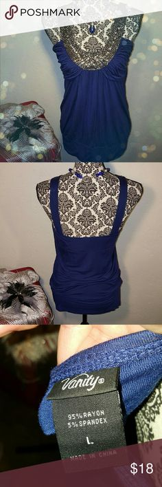 SALE!!  VANITY TOP Was listed for $18!  I got this top from vanity to wear to a wedding.   It is heavily embellished around the front neckline of the shirt in silver toned beads.  There is a band around the bottom the the shirt,  very comfortable.   You can dress this up or wear with jeans and heels.  Very pretty top!  Only wore a couple times,  in very good condition. Vanity Tops