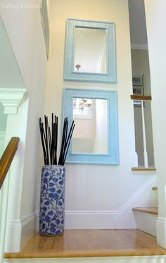Use mirrors to brighten a stairwell. #PaintItBlue